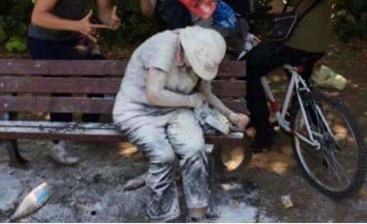 The image that sparked a national outcry - a woman on a bench pelted with flour and eggs by a group of teenage boys in Bury St Edmunds. (5798821)