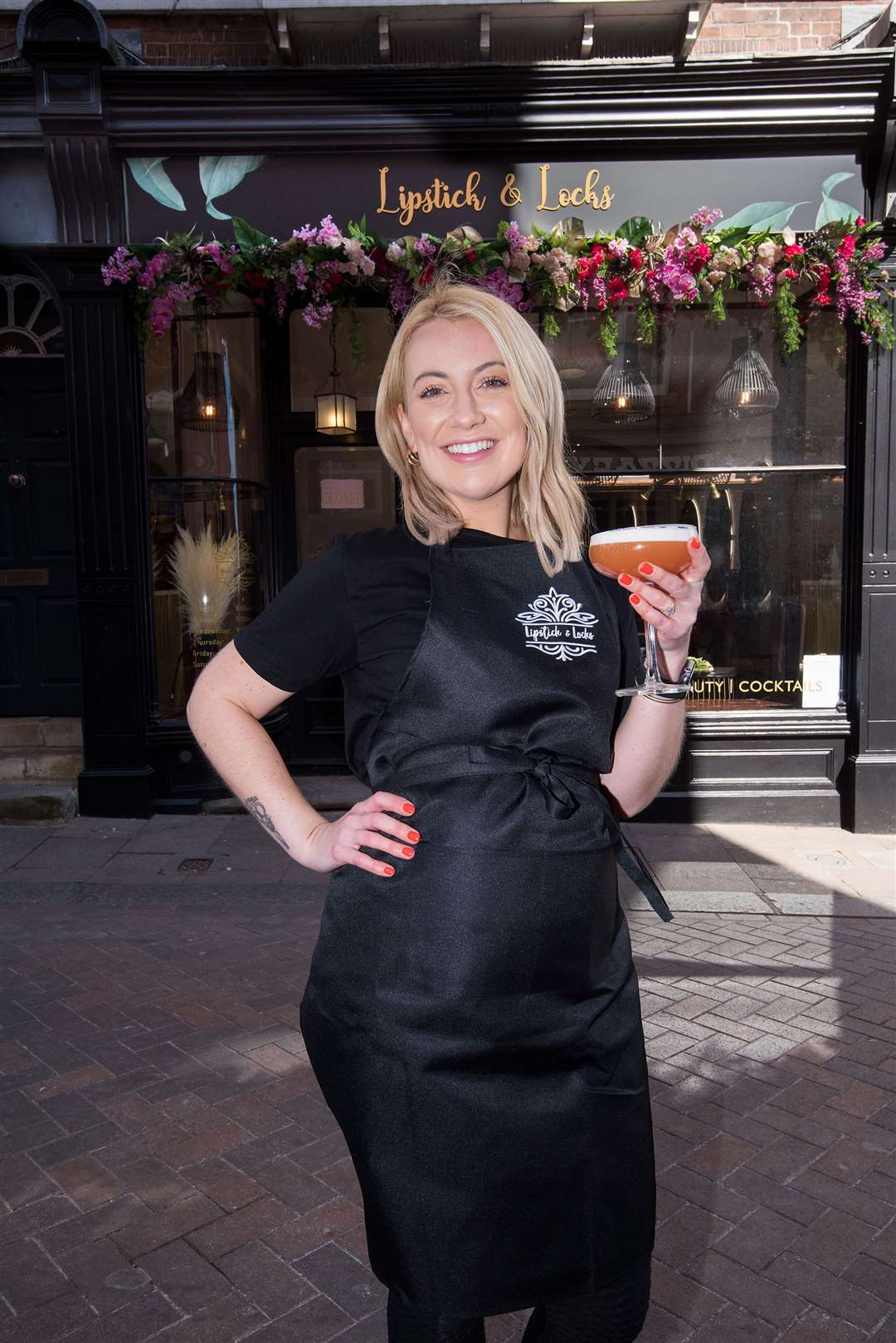 Abi Cutter, of Lipstick and Locks, raises a glass ahead of opening. Picture: Mark Westley