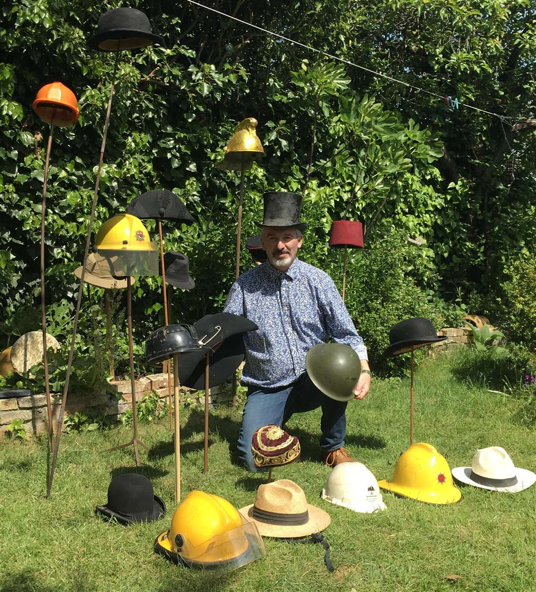 David Palmer with some of the hats. The one with a safety pin is said to have been worn by Spike Milligan (2105975)