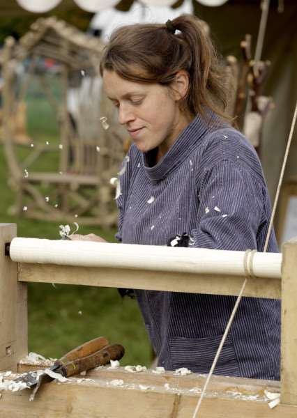 Porringer, Suffolk. Wood Fair weekend at Ickworth House. Tilly Mercer of East Harling, wood turning on a pole lathe. ''Picture: MARK BULLIMORE ANL-160810-223649009