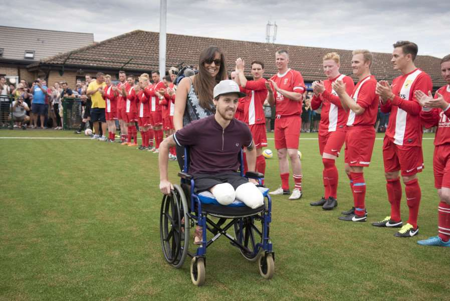 Shaun Whiter with fiancee Charlotte Way receive a players' guard of honour at Sunday's match