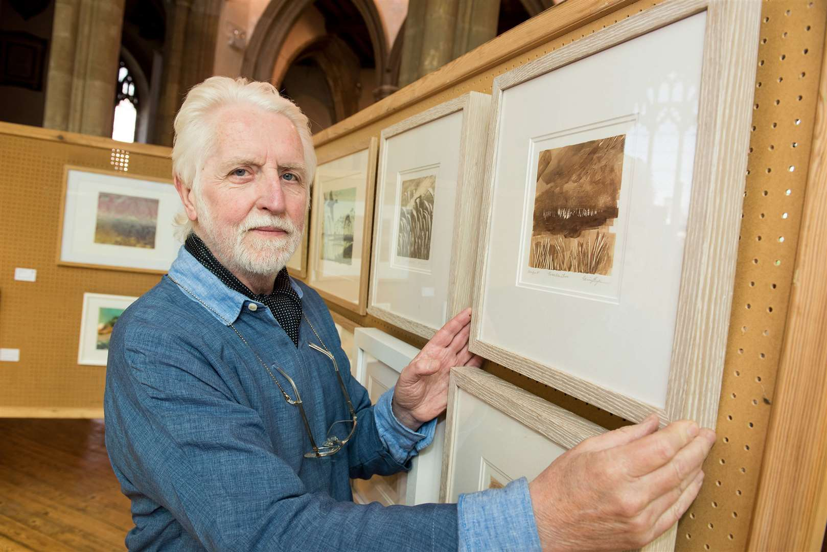 SUDBURY: Gainsborough Printmakers Art Exhibition at St Peter's Church Terry Bryan with some of his work. Picture by Mark Westley. (10282833)