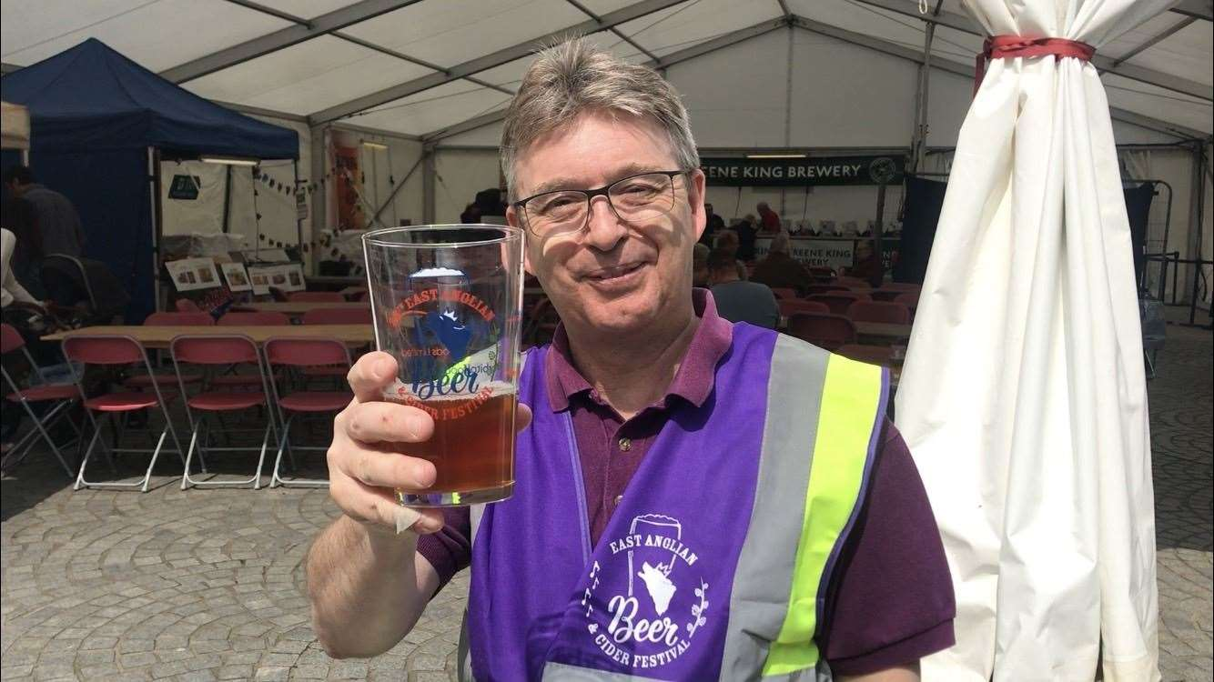Martin Bate, organiser of the East Anglian Beer & Cider Festival, raises a glass on the event's opening day in 2019.