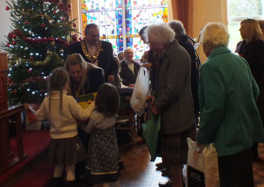 Roger and Pauline Andre receive gifts at the annual Toy Service at the Methodist Church ANL-141212-103610005