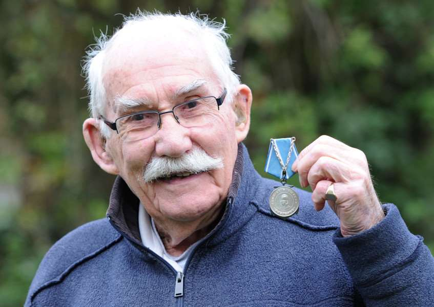 Retired wing commander Bryn Lewis with his Russian Ushnakov Medal for his Arctic Convoy duties ANL-161212-233526009