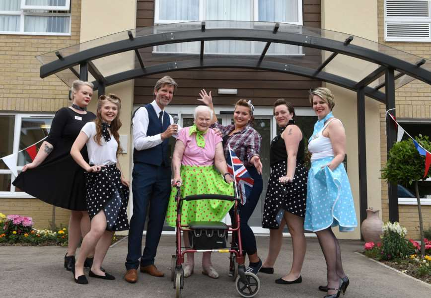 The Care UK Davers Court team with (centre) resident Phyllis Rampling and (left from centre) singer Les Trutch, enjoying a 1950s-themed party for Care Home Open Day. ANL-160622-161539001