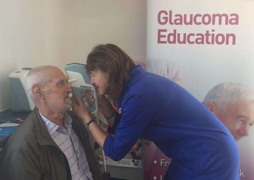 Haverhill Rovers fan Len Russell receiving his free pressure check from senior optometrist Joanna Williams ANL-161028-125908001