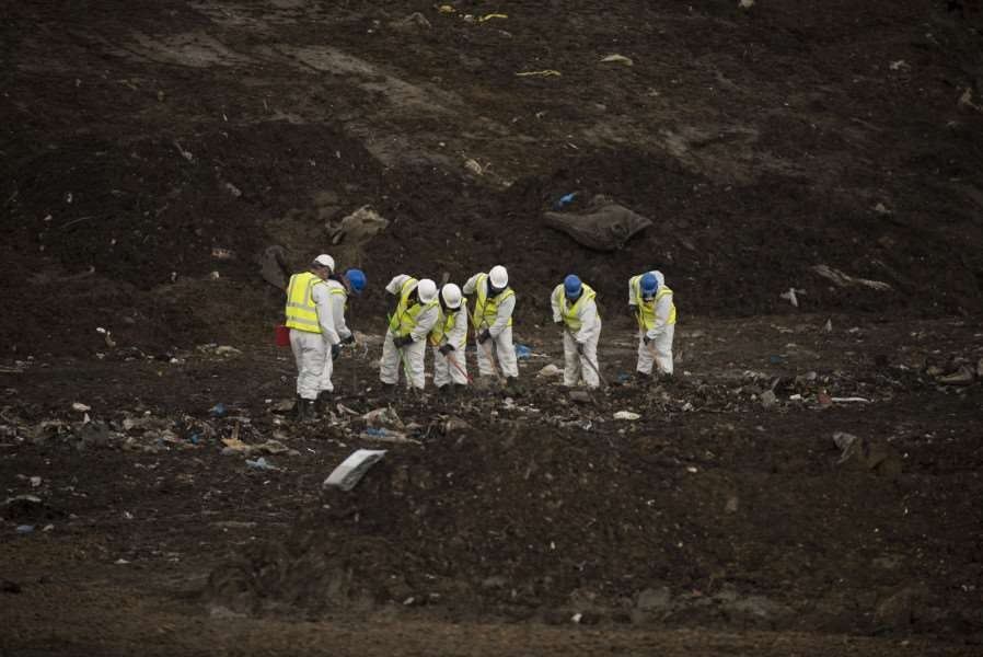 Police officers search the landfill site at Milton in Cambridgeshire as part of the continuing investigation into Corrie McKeague's disappearance.'Picture Mark Westley