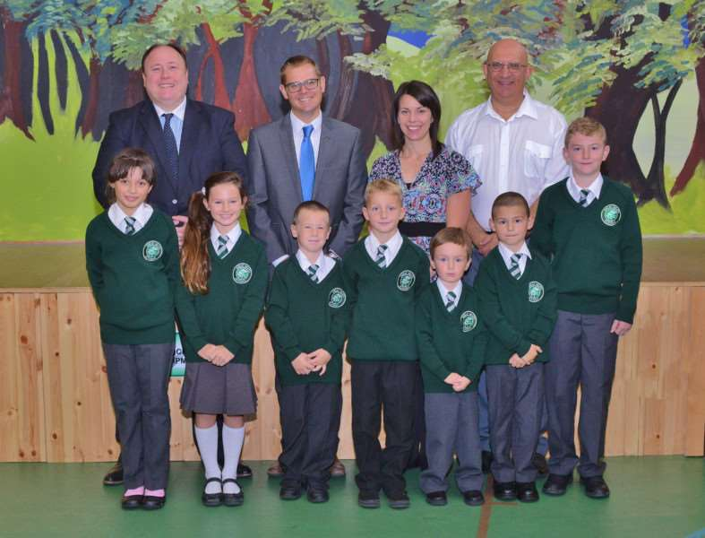 Great Heath Academy pupils in their new uniforms. Pictured with the children are Steven Vincent, Principal, Ben Jeffery and Naomi Brown, vice principals and Louis Busuttil, governor.