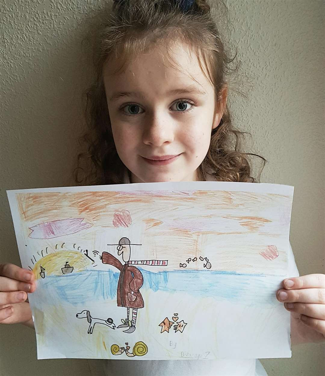 Eliza Turner-Cobbold with a copy of the thank you picture she did for artist Sam Toft (5630953)