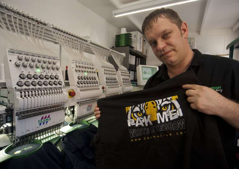 Bobby Mather with Production Print Embroidery's embroidery machine ANL-150704-231312009