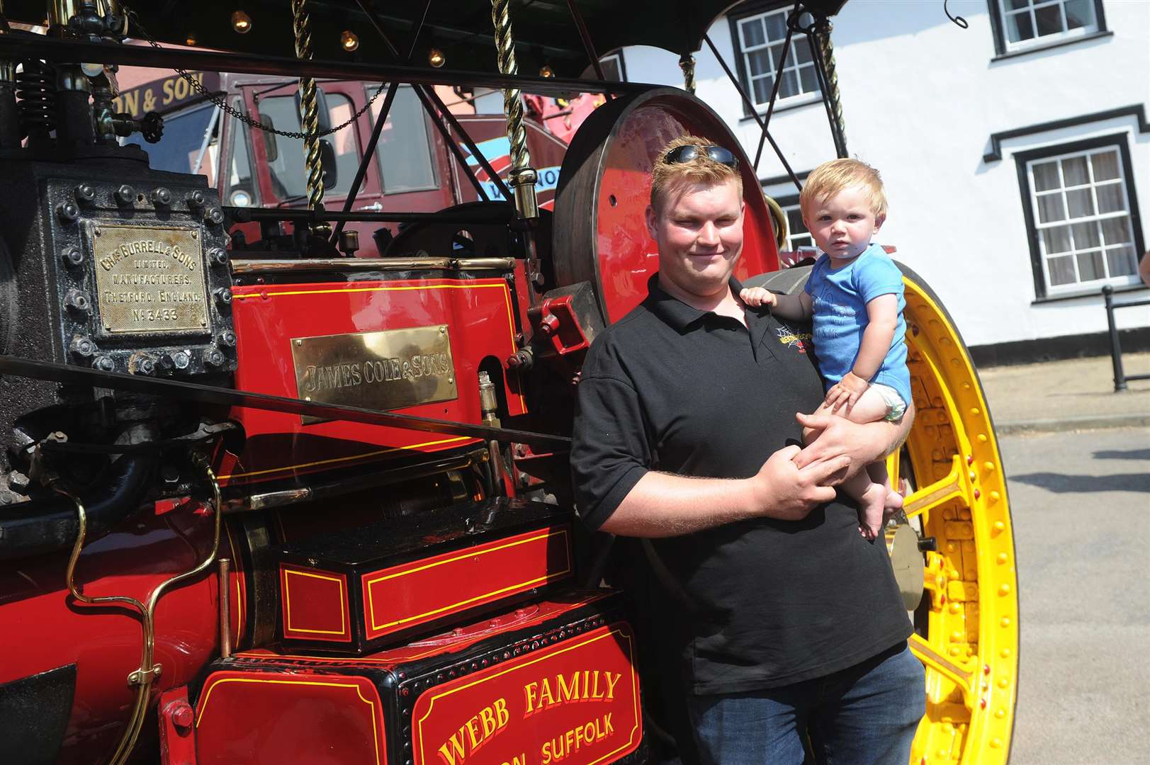 Long Melford Street Fair..Pictured: Chris Webb with son Charlie (11 months) with his 1912 Burrell Steam Engine ... PICTURE: Mecha Morton. .. (2807949)