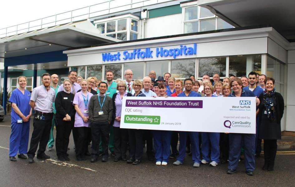 Staff at West Suffolk NHS Foundation Trust celebrating an outstanding CQC rating