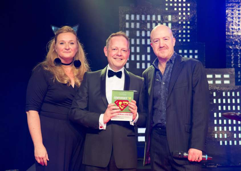 Coversure managing director Sarah Darling with Lee Parker and awards host Andy Parsons.