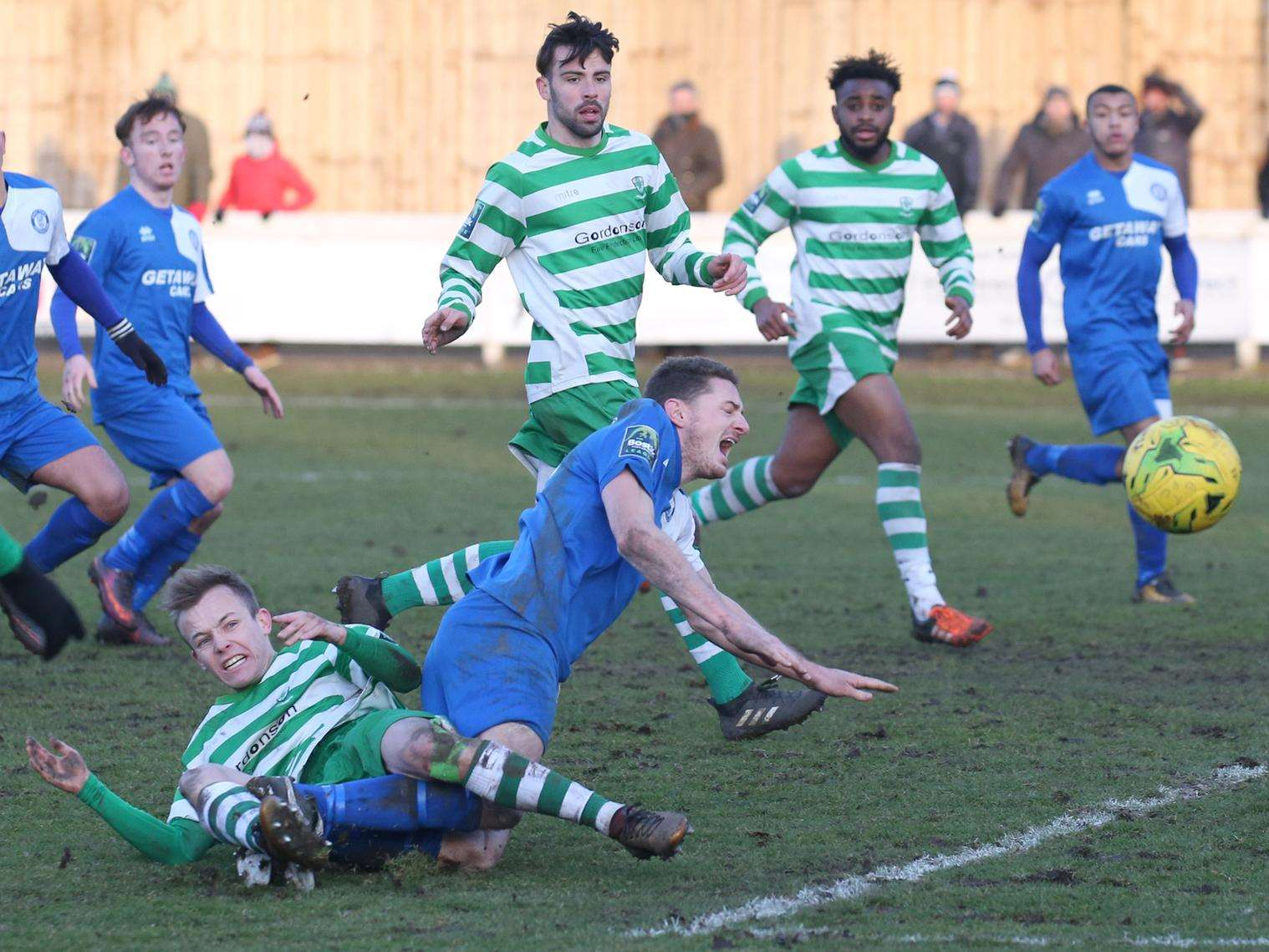 CONTROVERSIAL: Bury Town's Ollie Hughes wanted a penalty for this tackle, but saw the referee give it the other way Picture: Richard Marsham