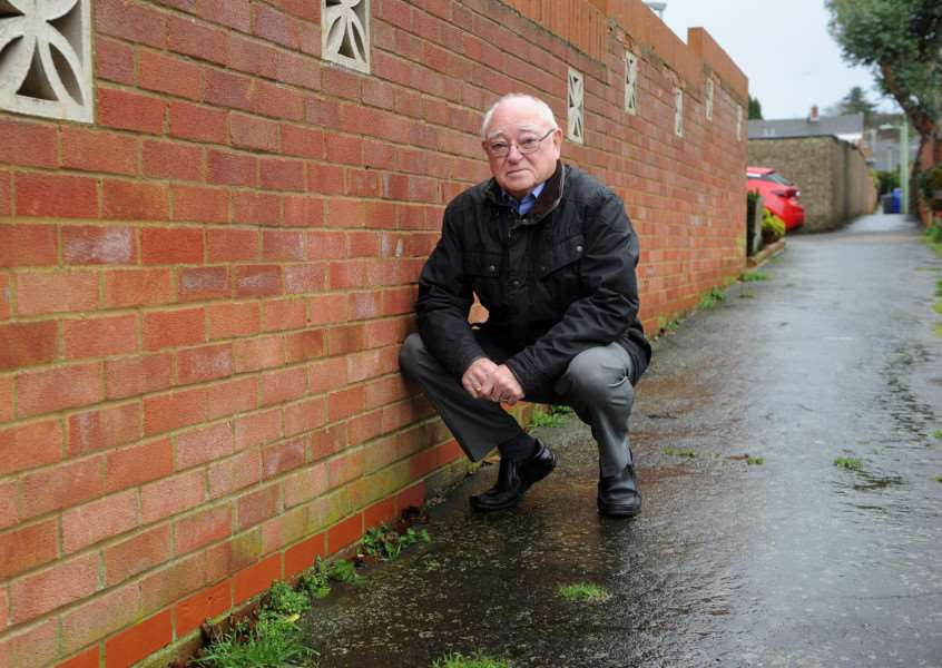 Frank Ayling, 78 is highlighting the bad state of the pavement in front of his home''''PICTURE: Mecha Morton