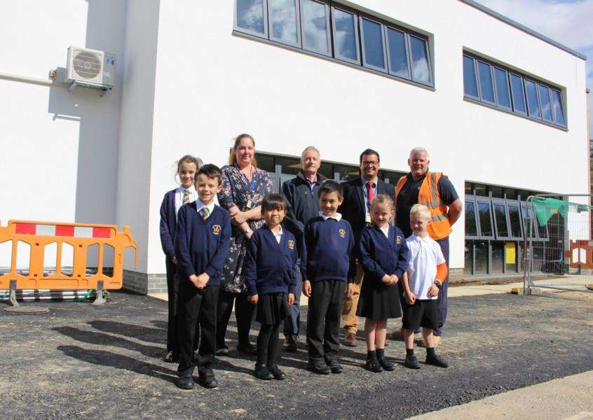 Staff and students join the project team from Cocksedge Building Contractors outside the new building at Coupals Primary Academy in Haverhill. Picture: Gooderham PR.