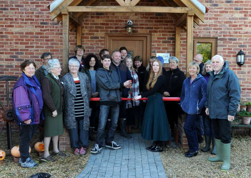 Care Farm staff, volunteers, past and present users and EU agricultural fund members at the barn opening ANL-160711-155256009