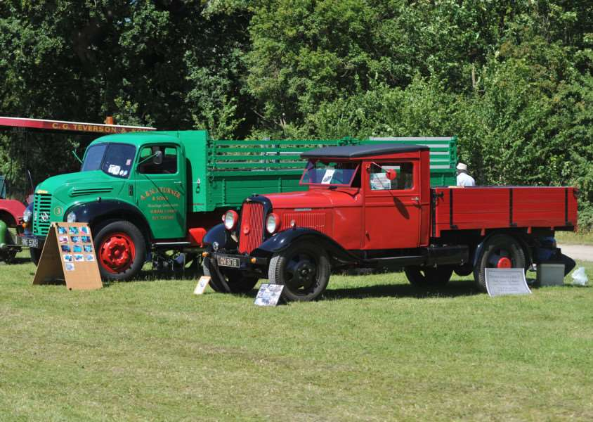 Two beautifully restored Dodge trucks: the green one dates from 1956 and the red one from 1935