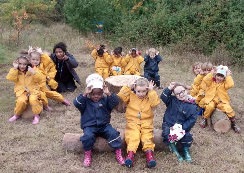 Reception year pupils at St Felix RC Primary School using their new Forest School seating are. Picture: Steve Barton