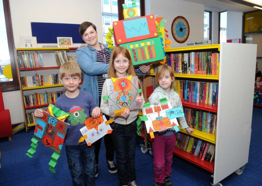 Children were at Bury Library to make robot clocks''Pictured: Ben (5), Anna (8) and Rosa (5) Williams with their robot clocks, along with Rachel Porter (Library and Information Advisor) ANL-160404-002406009