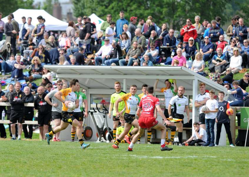 FINALISTS: Bury head towards the try line during their Open final contest with Bulldogs