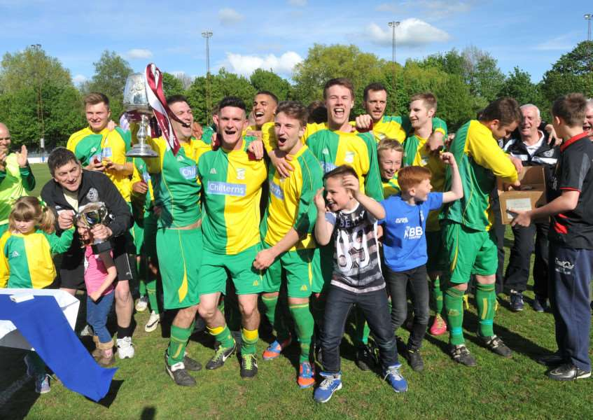 GOING UP? Lakenheath - pictured celebrating a cup win in 2015 - are keen to join the Thurlow Nunn League set-up