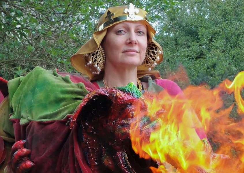 Queen Freyja with Krispin the fire breathing dragon