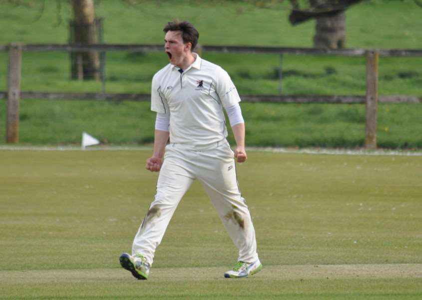 Off spinner Callum Brunning celebrates taking a wicket