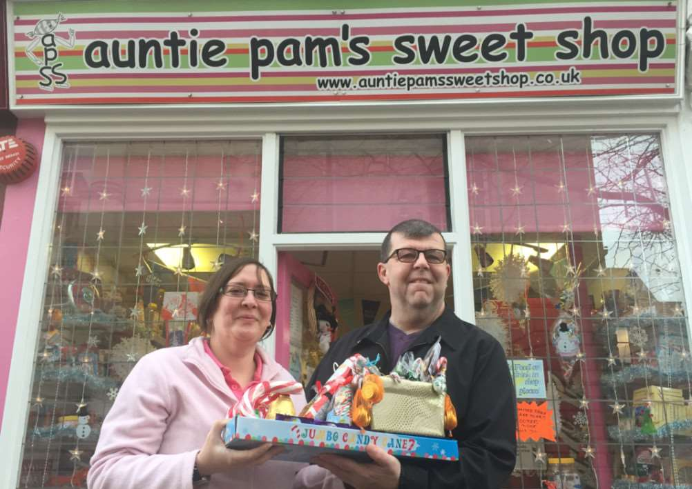 Helen Gibbon, manager at Auntie Pam's, presents the 'sweet sleigh' to Terry Price ANL-141229-141703001