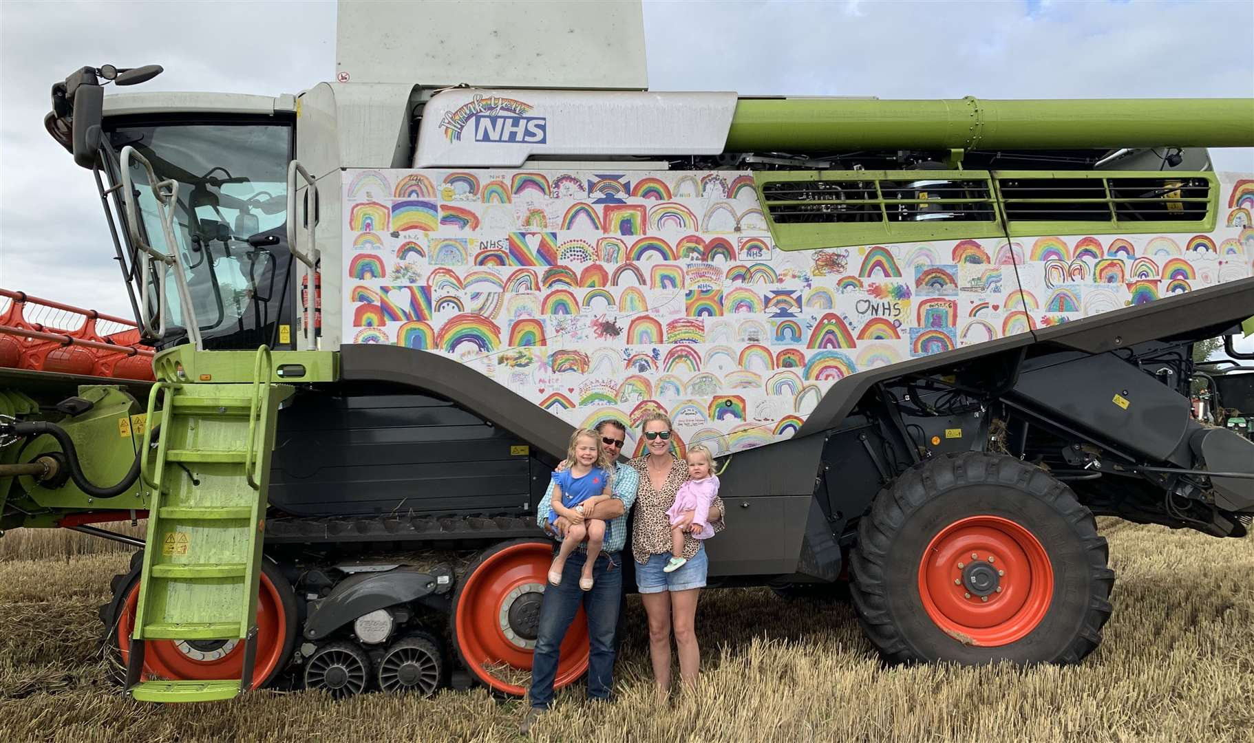 Thomas and Sophie Clayton (with daughters Georgia and Arabella). Harvester brand Claas supplied four prize bundles for a charity competition.