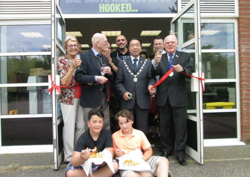 St Edmundsbury mayor Patrick Chung joins Moreton Hall councillors, enthusiastic young customers and the staff of the new Moreton Kebab and Fish Shop for the chippy's official opening ANL-150626-145824001