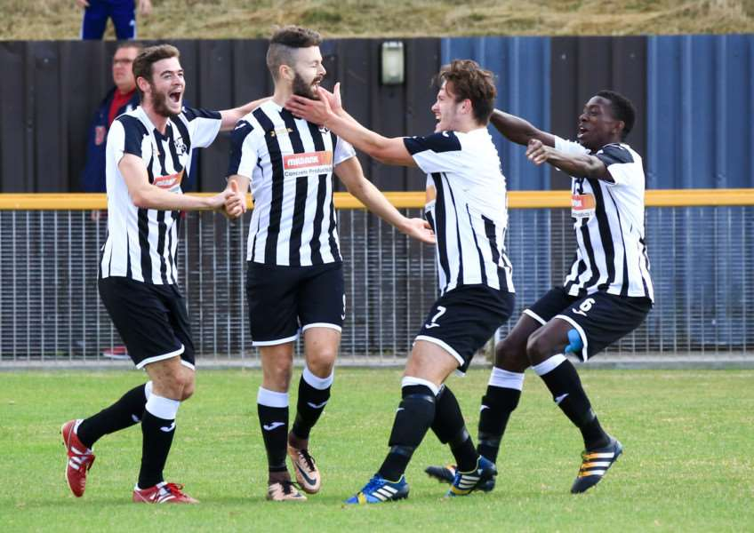 CELEBRATION TIME: Halstead Town's Tom Cook is congratulated after his opening goal at Thurrock on Saturday Picture: www.rogercuthbert.com
