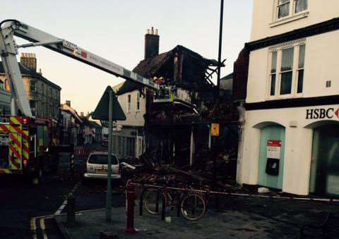 Fire crews at the scene in Market Hill making the remains of the fire damaged building safe this morning.