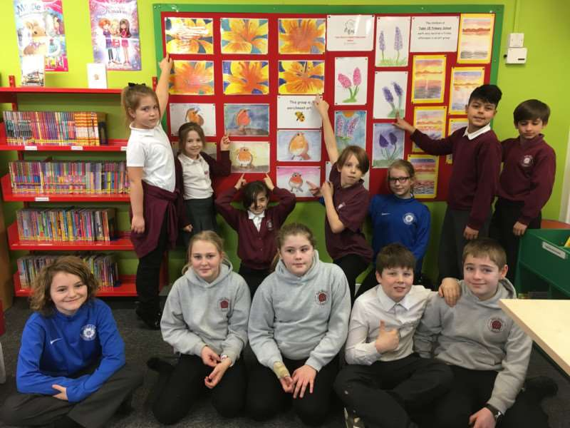 Tudor Primary School pupils show off their art work at a new display in Sudbury Library.