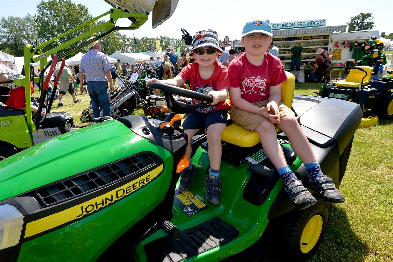 The Annual Hadleigh Show. Oliver (4) and Jacob (6) Davidson riding a John Deere. (2088013)