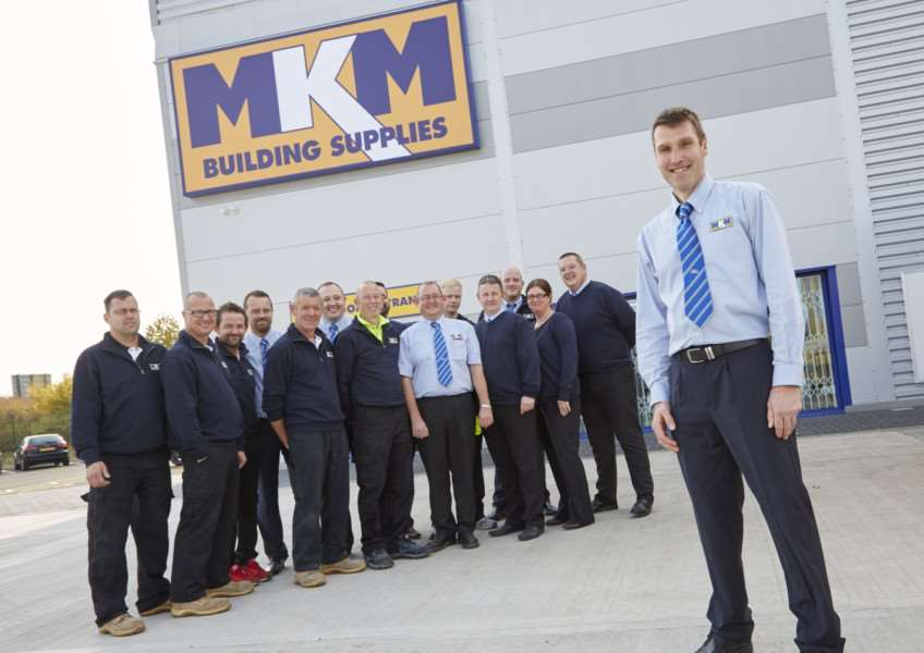 MKM Haverhill's new team toast the opening of the branch.