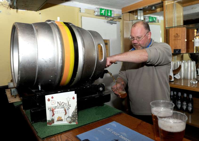 Terry Wilde pulls a pint at the pub he has taken on in Troston ANL-170301-154428009