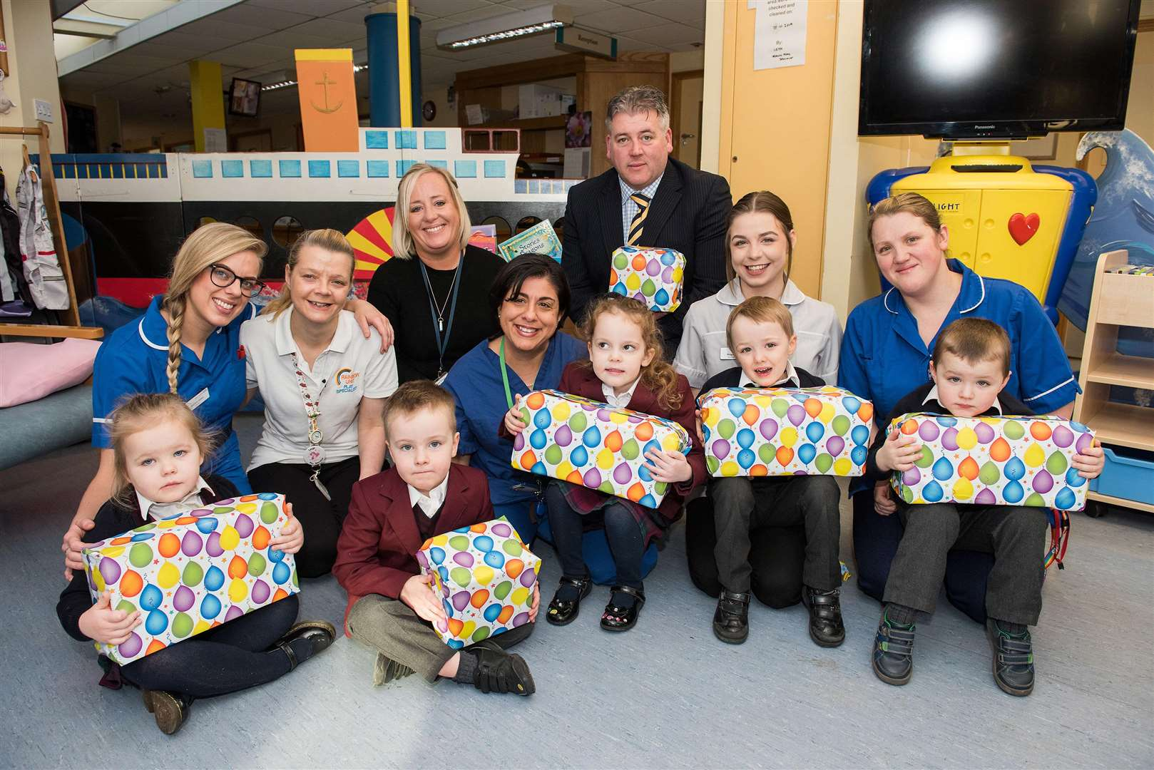 Nursery children with Mervyn Watch, headteacher and Julie Last, head of early years at South Lee School handing over toys to the Rainbow Ward,West Suffolk Hospital. Picture Mark Westley.