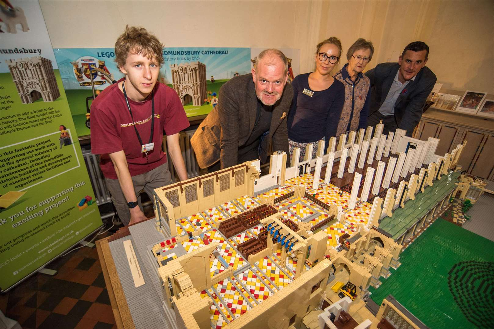 BURY - St Edmundsbury Cathedral LEGO project progress update.Hannah Ratcliffe vists and Comms manager, Matt Cadwell project manager, Joe Hawes Cathedral Dean, Rod Mansel and Margaret Smith volunteer builders Picture Mark Westley. (4002321)