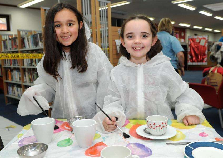 Emily Denmark, eight, and Daisy Cox, eight, dusting for fingerprints PICTURE: Mecha Morton