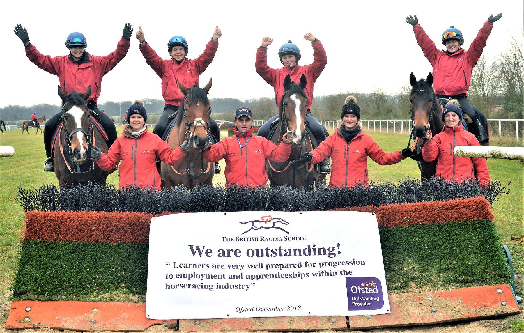 Winners ...Celebrating being graded outstanding by Ofsted are British Racing School students, back, from left: Emma Markham, Chloe Cheverton, Alana Styles and Katie McSevich, with instructors Suzy Berry, Ray O'Brien, Agnieszka Slobodzain and Anna Savage