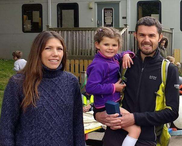 Ashdon Fun Run 10K winner Nick White and daughter Daisy, who won the Under 8's 3k Frun Run, with race organiser Carrie Peel. Picture by Gary Brown.