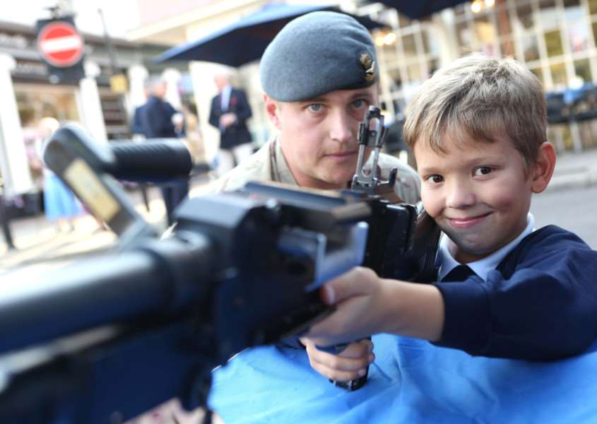 Picture by Richard Marsham'Finn Meijerink, 7 takes aim with help from Flight Lieutenant Ben Hewitt during the celebrations in Bury St Edmunds to mark the Queen becoming the longest serving monarch. ANL-150909-165711009