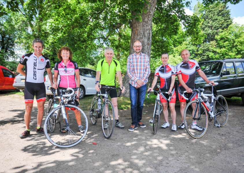 DISTANCE RIDERS: Riders return from a hard day cycling in the Cycle Club Sudbury Audax rides and are pictured with organiser Centre Andrew Hoppit (centre)
