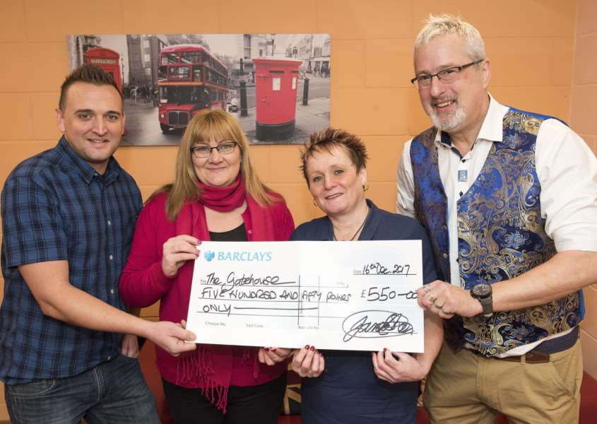 Carl Whitehouse and James Sheen from We Love Bury St Edmunds present cheque to Elaine Channen and Amanda Bloomfield from Gatehouse. 'Picture: Mark Westley.