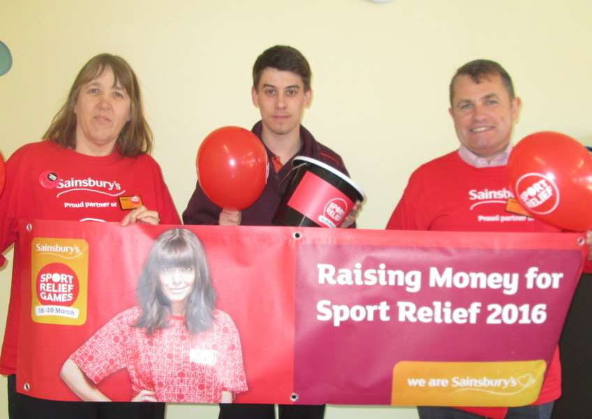 Sainsbury's Mildenhall store manager Alan Bedwell with colleagues Helen Gower and Danny Wheele ready to cheer on the Sport Relief Games.