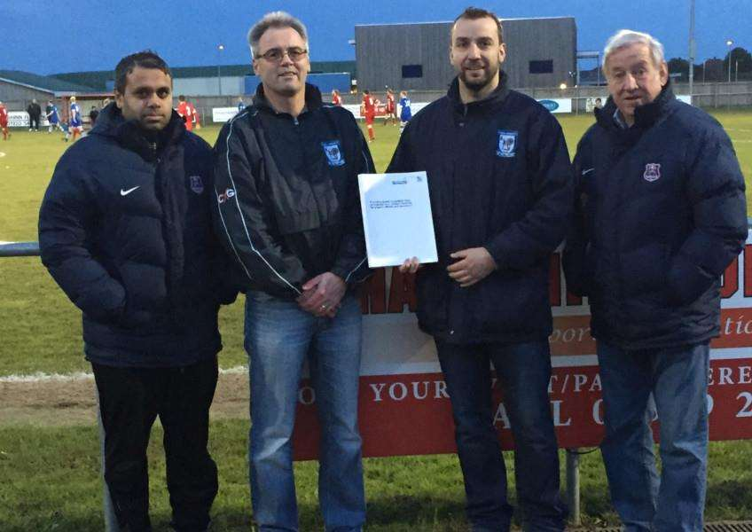 From left: Peter Betts (HCSA facility manager), Dave Hardwick (Haverhill Borough committee member), Ben Cowling (Borough chairman) and Bruce Badcock, HCSA board member, with the agreement from the Football Stadia Improvement Fund to provide almost �48,000. ANL-160427-101229002