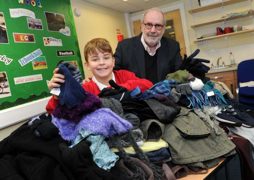 Max Ream, aged 8, has organised a collection of gloves, hats, scarves and warm clothing Bury Drop-In. ''Pictured; Max Ream with David Bonnett from the Drop in ANL-161219-190505009