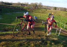 ON THE RUN: Matt Denny and Richard Stiff shoulder their bikes and get running on a difficult course